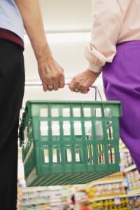 Couple Holding Shopping Basket